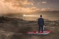 Composite image of businessman in boat Stock Image