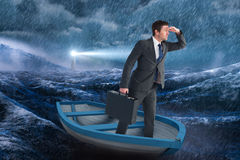 Composite image of businessman in boat Royalty Free Stock Photos