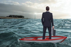 Composite image of businessman in boat Royalty Free Stock Image