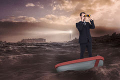 Composite image of businessman in boat with binoculars Royalty Free Stock Image