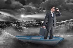 Composite image of businessman in boat with binoculars Royalty Free Stock Photography