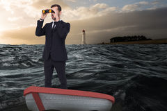 Composite image of businessman in boat with binoculars Royalty Free Stock Images
