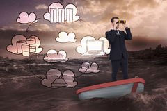 Composite image of businessman in boat with binoculars Stock Photo