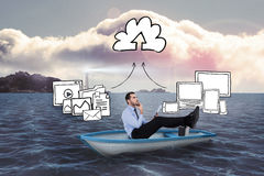 Composite image of businessman in boat with tablet pc Royalty Free Stock Photography