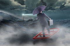 Composite image of businessman in boat with umbrella Royalty Free Stock Photo
