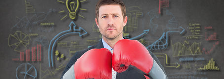 Composite image of businessman with boxing gloves Royalty Free Stock Photography