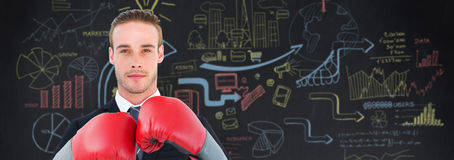 Composite image of businessman with boxing gloves Stock Images