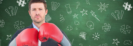 Composite image of businessman with boxing gloves Stock Photography