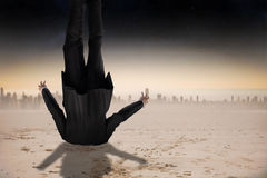 Composite image of businessman burying his head Stock Photo