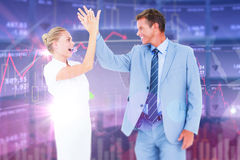 Composite image of businessman and businesswoman greeting each other Stock Image