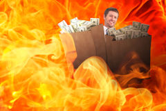 Composite image of businessman carrying bag of dollars Royalty Free Stock Photography
