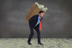 Composite image of businessman carrying bag of dollars Royalty Free Stock Images