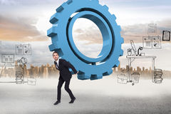 Composite image of businessman carrying something with his hands Stock Image