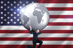 Composite image of businessman carrying the world Stock Photography