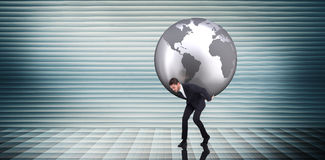 Composite image of businessman carrying the world Royalty Free Stock Image