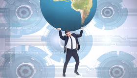 Composite image of businessman carrying the world Stock Photo