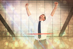 Composite image of businessman celebrating success with arms up Royalty Free Stock Images