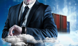 Composite image of businessman checking the time on watch Royalty Free Stock Images