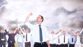 Composite image of businessman cheering with clenched fist Stock Photo