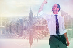 Composite image of businessman cheering with clenched fist Royalty Free Stock Photography