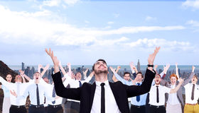 Composite image of businessman cheering with hands raised Stock Photos