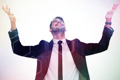 Composite image of businessman cheering with hands raised Royalty Free Stock Image