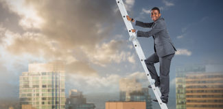 Composite image of businessman climbing up ladder Stock Photos