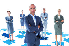 Composite image of businessman colleagues arm crossed Royalty Free Stock Images