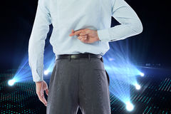 Composite image of businessman crossing fingers behind his back Stock Photos