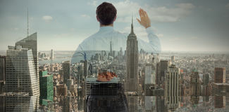 Composite image of businessman crossing fingers behind his back. Businessman crossing fingers behind his back against city skyline Royalty Free Stock Photos