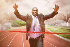 Composite image of businessman crossing the finish line Royalty Free Stock Photos