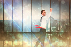 Composite image of businessman crossing the finish line Stock Photography
