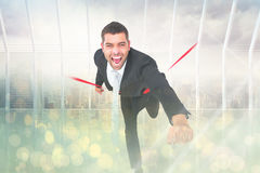 Composite image of businessman crossing the finish line Royalty Free Stock Images