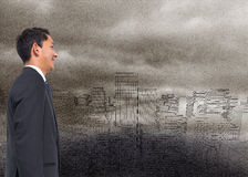 Composite image of businessman on digital city in the fog Stock Photos