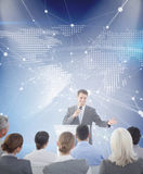 Composite image of businessman doing speech during meeting Stock Image