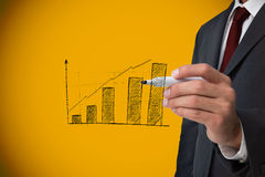 Composite image of businessman drawing graph Stock Image
