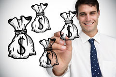 Composite image of businessman drawing money bags Royalty Free Stock Image