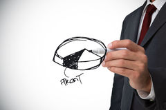 Composite image of businessman drawing pie chart Royalty Free Stock Image