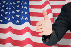 Composite image of businessman extending arm for handshake Stock Photo