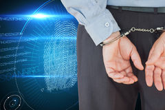 Composite image of businessman in formals with handcuffs Stock Images