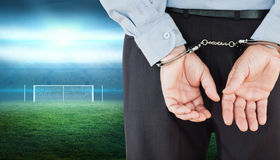 Composite image of businessman in formals with handcuffs Stock Image