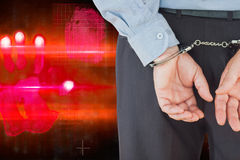Composite image of businessman in formals with handcuffs Royalty Free Stock Image