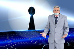 Composite image of businessman gagged Stock Image