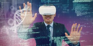 Composite image of businessman gesturing while wearing vr glasses. Businessman gesturing while wearing vr glasses against pink and purple background Stock Images