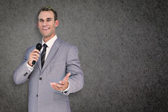 Composite image of businessman giving speech Royalty Free Stock Photo