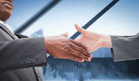Composite image of businessman going shaking a hand Royalty Free Stock Image
