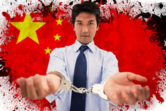 Composite image of businessman with handcuffs Royalty Free Stock Image