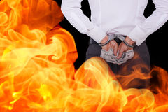Composite image of businessman in handcuffs holding bribe Stock Photography