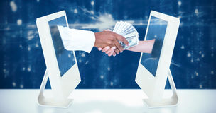 Composite image of businessman handing over banknotes to female colleague royalty free stock photo