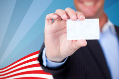 Composite image of businessman holding blank card against white background. Businessman holding blank card against white background against focus on line Stock Photo